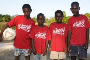 haiti boys in their red st joseph's tshirts