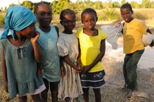haiti young girls and boy with rice bag